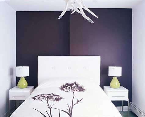 color on the background makes the bedroom seem bigger the purple wall