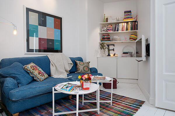 Books Corner Room With Blue Sofa And Cushions