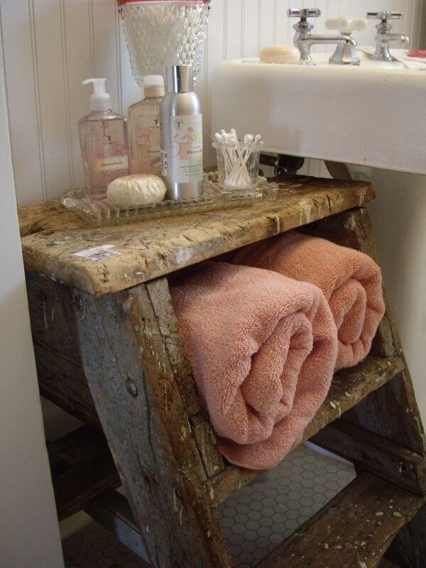Convert and Old Ladder into a vintage towel storage mod