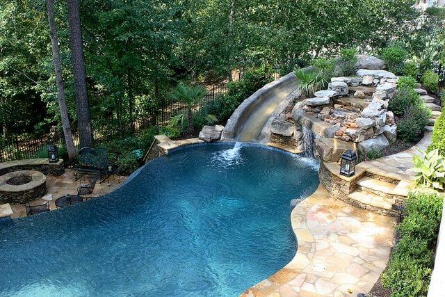 11 most beautiful swimming pools you have ever seen for Swimming pools with slides and waterfalls