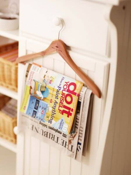Use a Coat Hanger to Display Your Magazines
