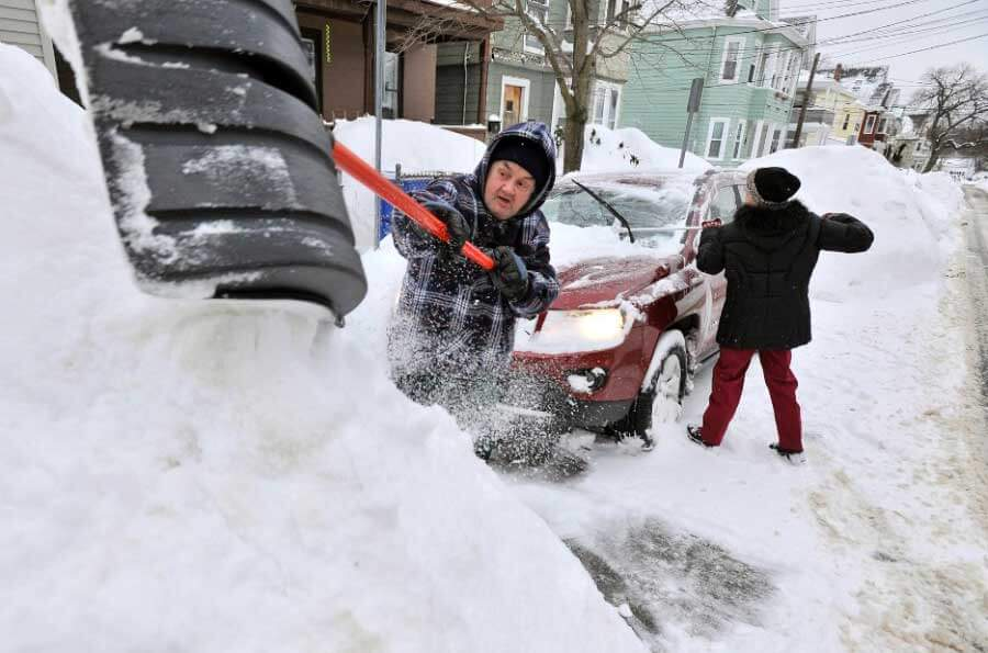 Shoveling out a car in Boston