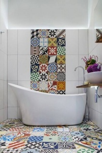 Colorful Large Floor And Wall Tile In A Small White Bathroom