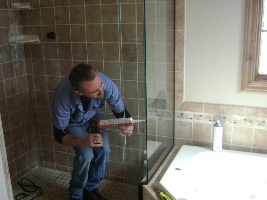 contractor installs shower in small bathroom