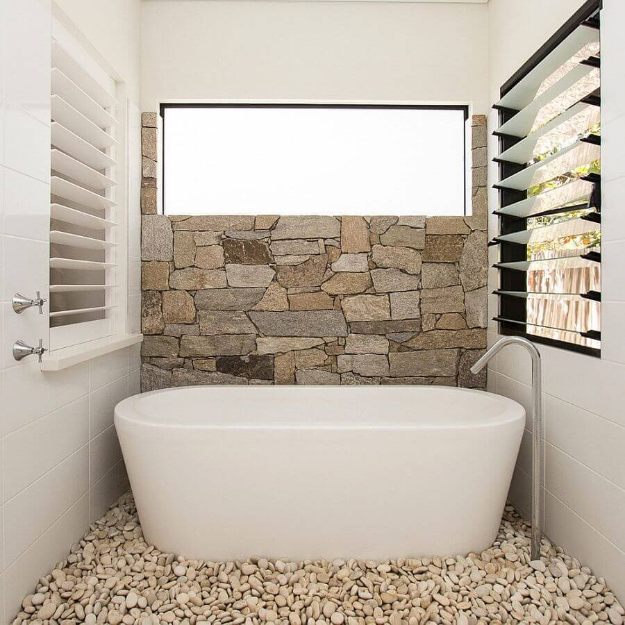 Beau Stone Tile Accent Wall In A Small Bathroom