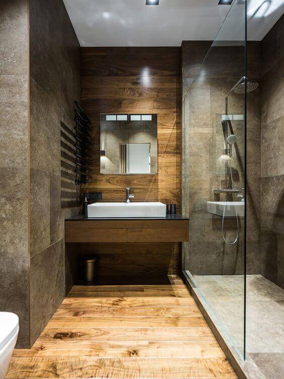 walk in shower in a luxury bathroom with stone tile and wood accents - Luxury Tile Showers