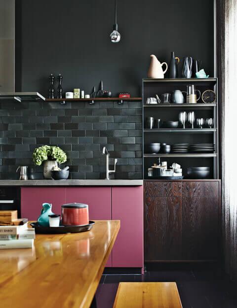 Unique Cabinet Design in a Small Black Kitchen
